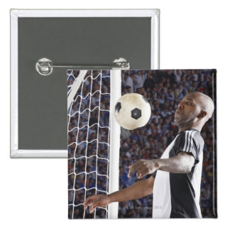 Soccer player facing mid air ball in goal mouth 15 cm square badge