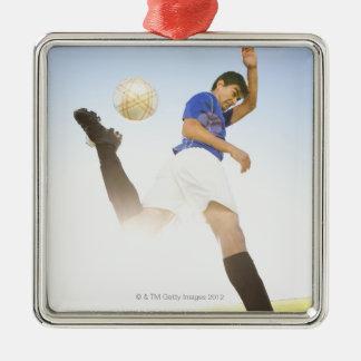 Soccer player jump kicking christmas ornament
