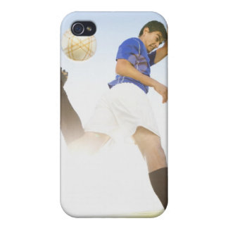 Soccer player jump kicking iPhone 4 cases