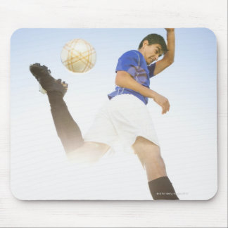 Soccer player jump kicking mouse mat