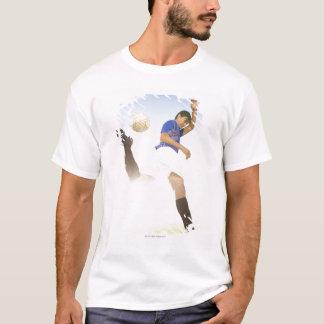 Soccer player jump kicking T-Shirt