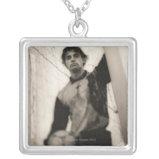 Soccer player standing behind net silver plated necklace