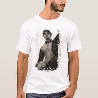 Soccer player standing behind net T-Shirt