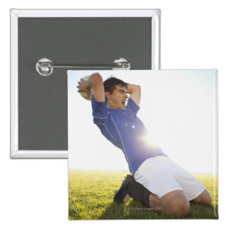 Soccer player throwing ball 15 cm square badge