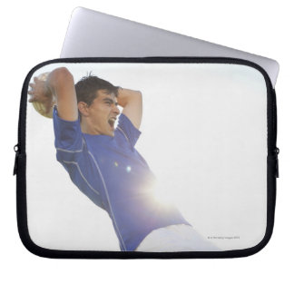 Soccer player throwing ball laptop sleeve