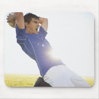 Soccer player throwing ball mouse mat