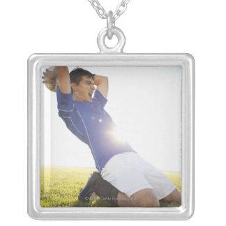 Soccer player throwing ball pendant