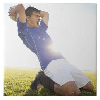 Soccer player throwing ball tile