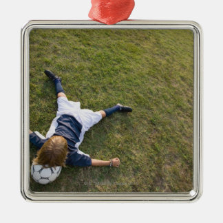 Soccer player with head on football christmas ornament