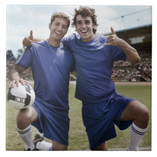 Soccer players cheering large square tile