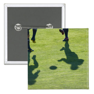 Soccer players doing drills. 15 cm square badge