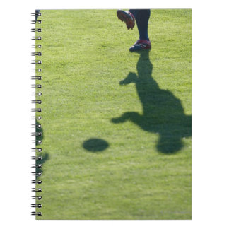 Soccer players doing drills. notebook