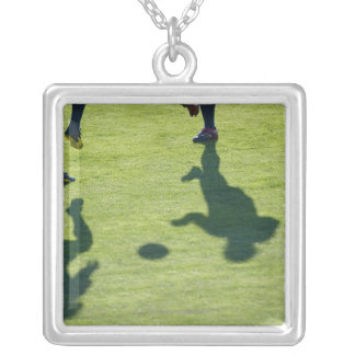 Soccer players doing drills. silver plated necklace