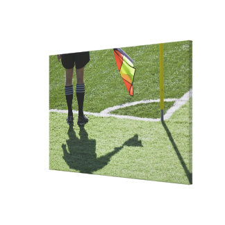 Soccer referee holding flag. canvas print