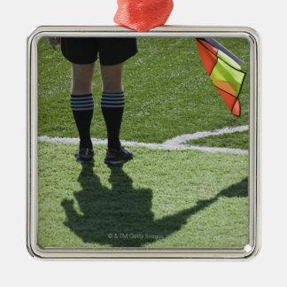 Soccer referee holding flag. christmas ornament
