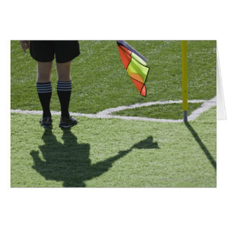 Soccer referee holding flag. greeting card