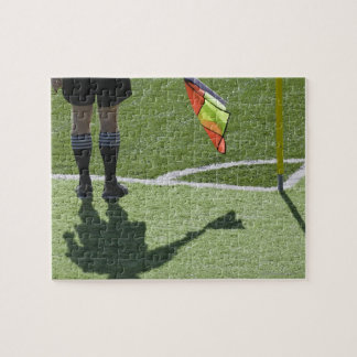 Soccer referee holding flag. jigsaw puzzle