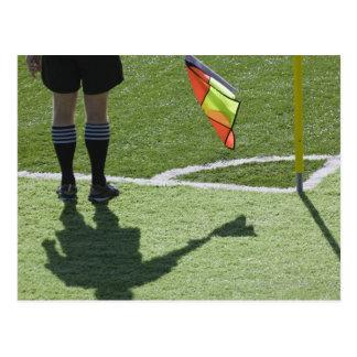 Soccer referee holding flag. postcard