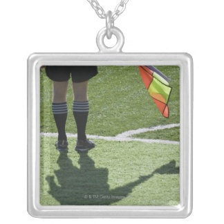 Soccer referee holding flag. silver plated necklace