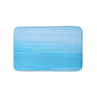 Soft shades of blue ocean in horizontal stripes bath mat
