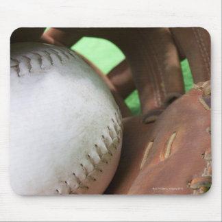 Softball in catcher's glove mouse mat