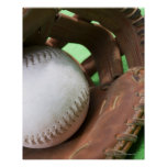 Softball in catcher's glove poster