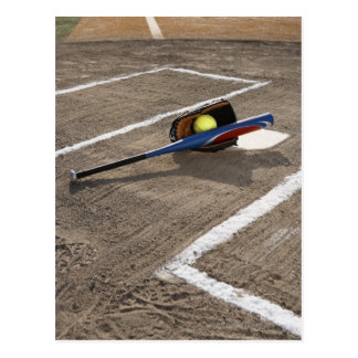Softball, softball glove and bat at home plate postcard