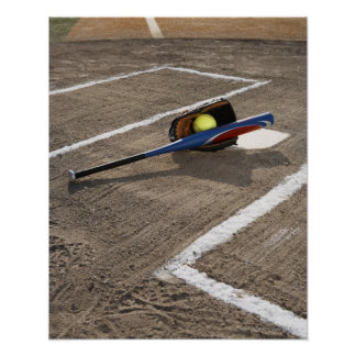 Softball, softball glove and bat at home plate poster
