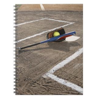 Softball, softball glove and bat at home plate spiral notebook