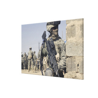 Soldier armed with a MK-48 Gallery Wrapped Canvas