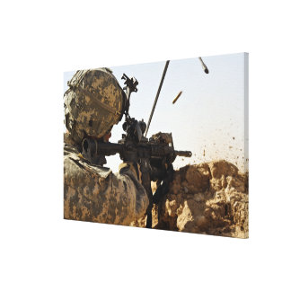 soldier engages enemy forces stretched canvas print