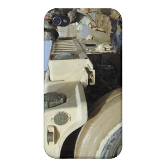 Soldier unties a rope to tow a humvee iPhone 4 covers