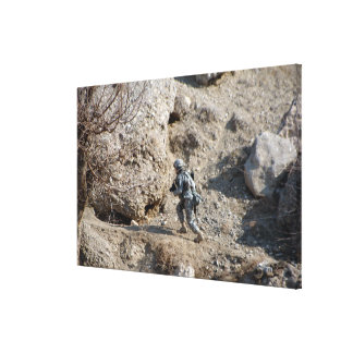 soldier walks up the side of a hill canvas print