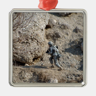 soldier walks up the side of a hill christmas ornament