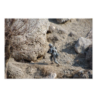 soldier walks up the side of a hill photo print