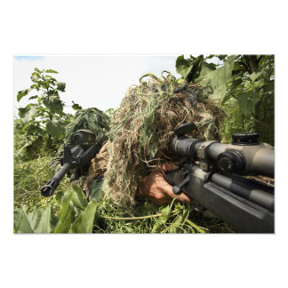 Soldiers dressed in ghillie suits photograph