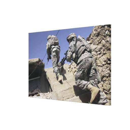 Soldiers running up staircase of a building canvas print