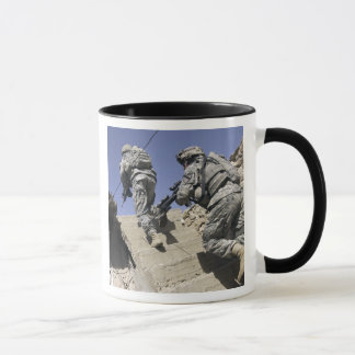 Soldiers running up staircase of a building mug