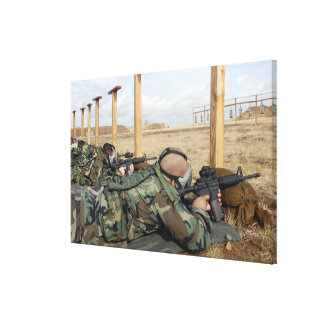 Soldiers sight M-4 rifles down range Canvas Print