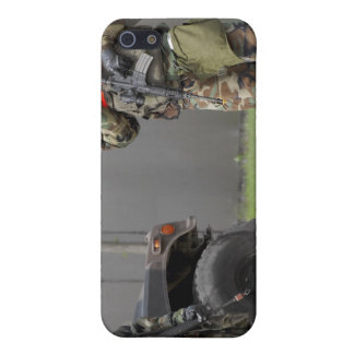 Soldiers stand guard at an intersection iPhone 5 cover