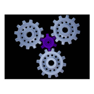 Some silver gears with a little purple post card