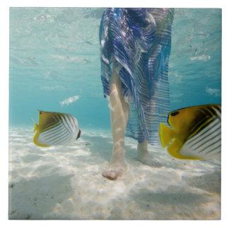 South Pacific, Bora Bora, female tourist walking 2 Tile