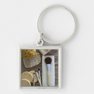 Spa detail of sponges and brushes key ring