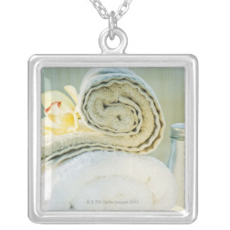 Spa towels and tropical flower silver plated necklace