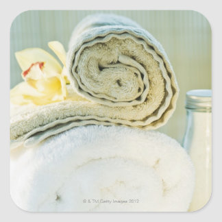 Spa towels and tropical flower square sticker