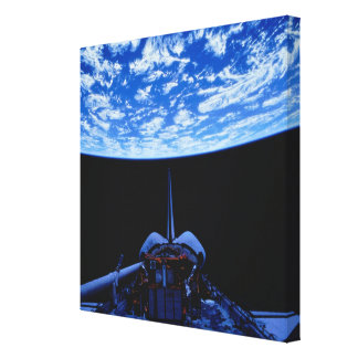 Space Shuttle and Earth Stretched Canvas Print