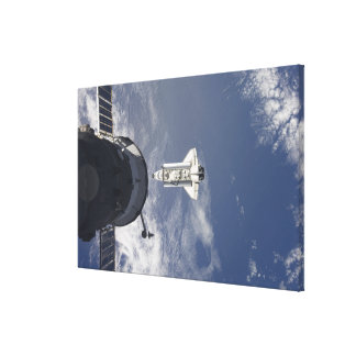 Space Shuttle Atlantis and a Russian spacecraft Canvas Print