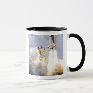 Space Shuttle Atlantis lifts off Mug
