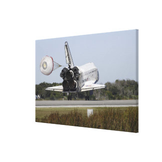Space shuttle Atlantis unfurls its drag chute Canvas Print