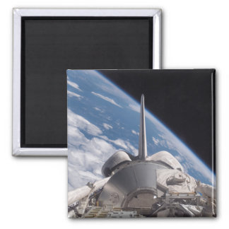 Space Shuttle Discovery backdropped by Earth Refrigerator Magnet